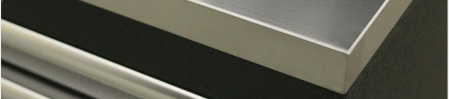 The corner of a stainless steel worktop fitted to a Sealey Premier modular cabinet.