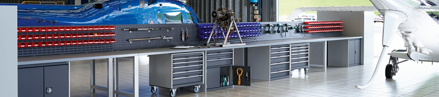 Bott Cubio cabinets in a helicopter hangar with worktops and back panels.