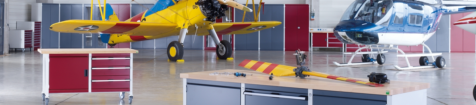 Mobile Bott tool cabinets in a plane hangar.