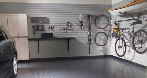 Garage storage using the walls. Slat-wall panels with hooks and baskets.