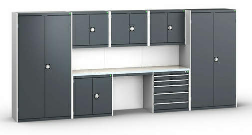 A light and dark grey Bott modular garage cabinet set with back panels and worktops.