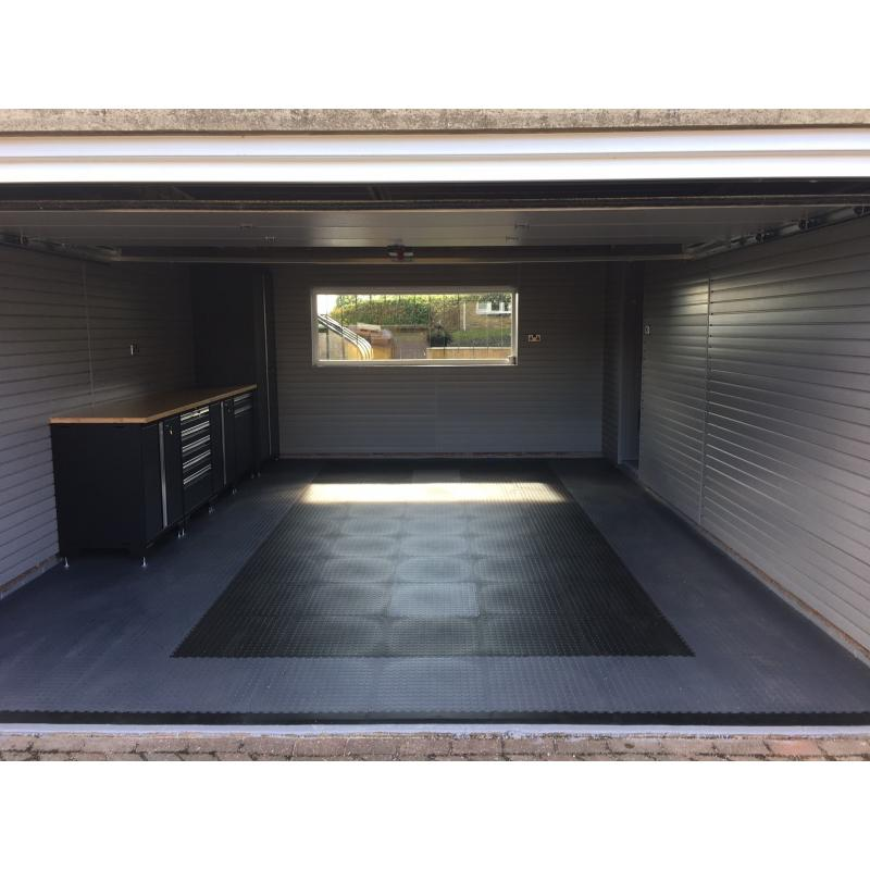 Double garage after fitting. Storewall panels, Pro Series cabinets and floor tiles