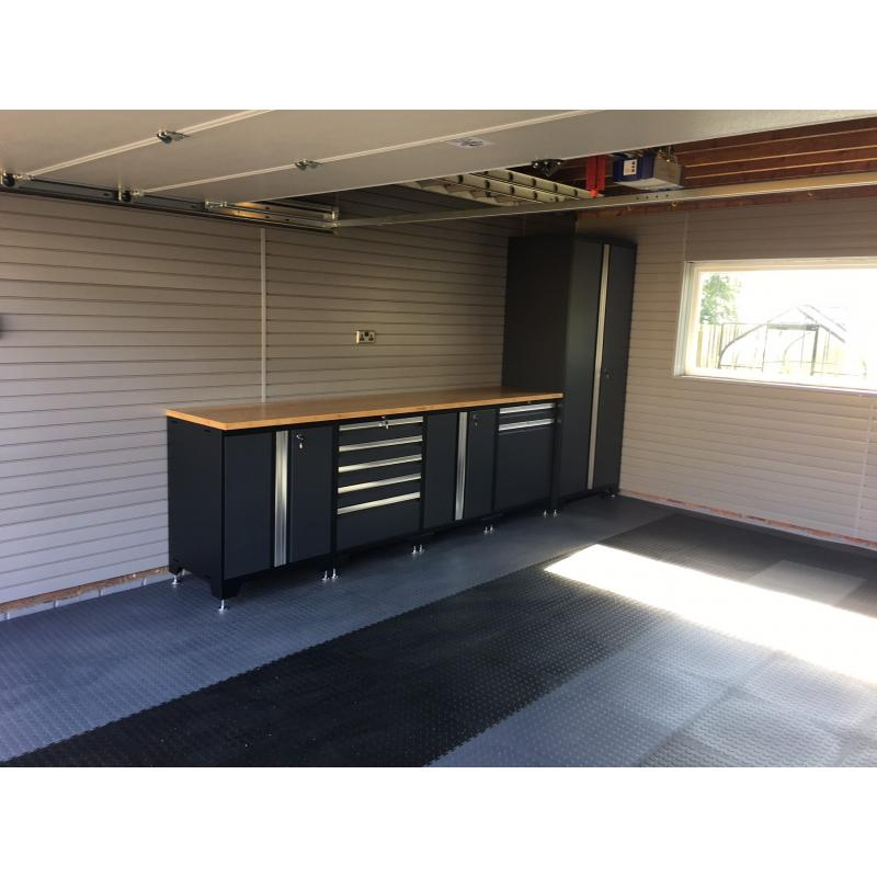 Double garage after fitting. Storewall panels, black/grey heavy duty cabinets and floor tiles