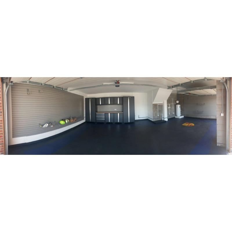 Garage fitted in July 2017, steel cabinets, floor tiles with Porsche logo, and wall storage.