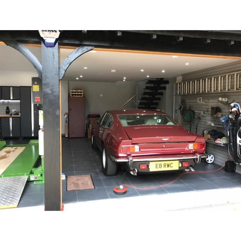 Aston Martin customer with Storewall, tiles and cabinets (left).