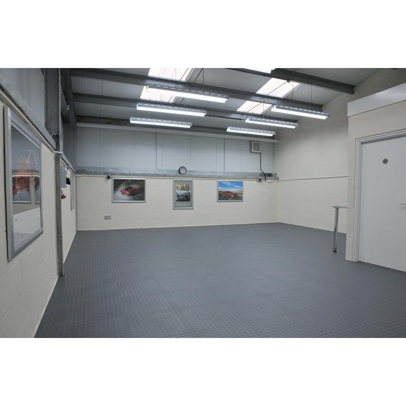 Garage floor tiles can transform any room - loose laid in a few hours