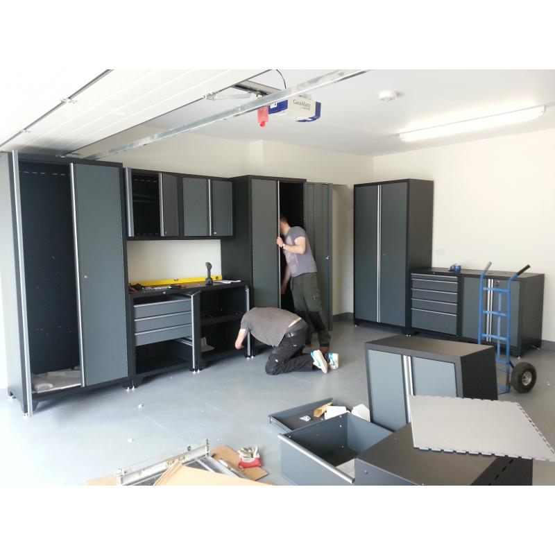 Pro Series cabinets being unpacked and positioned in a Devon residential garage