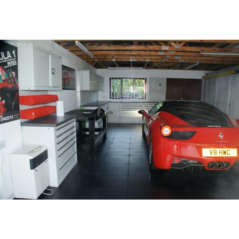 A large garage using light grey cabinets with black tiles and Ferrari 458.  GaragePride designed, installed by the customer.