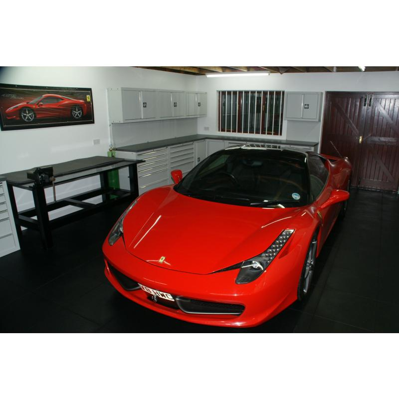 A gratuitous picture of a customer's Ferrari 458, with some cabinets behind.