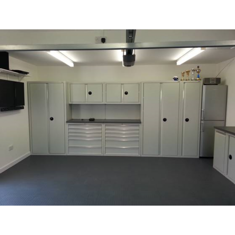 Cabinets in light grey, floor tiles and wall storage all supplied by GaragePride - Installed by the customer.