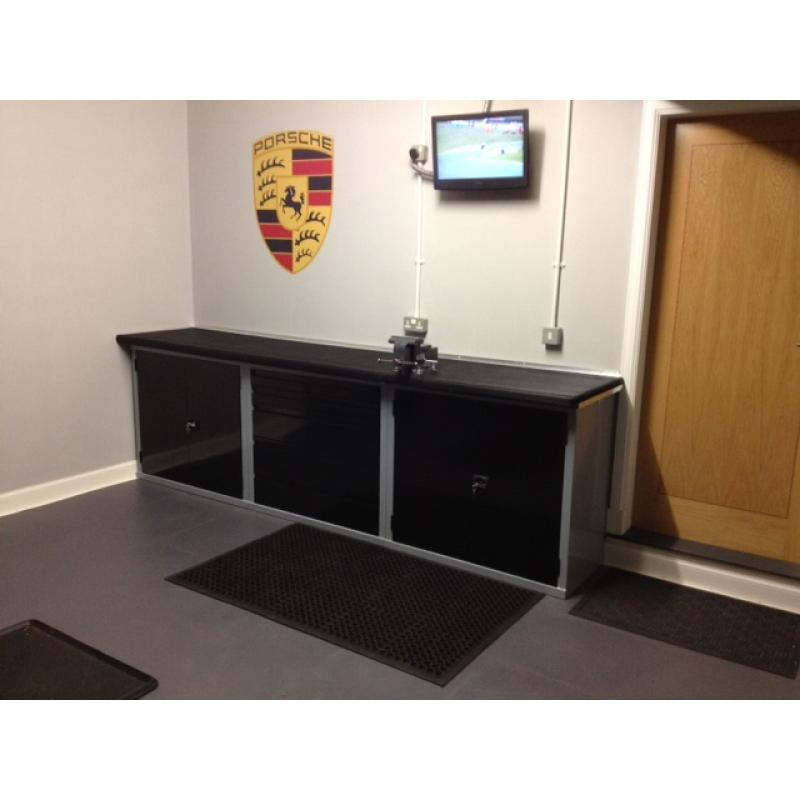 A simple but effective row of GaragePride cabinets with a worktop supplied by the customer.