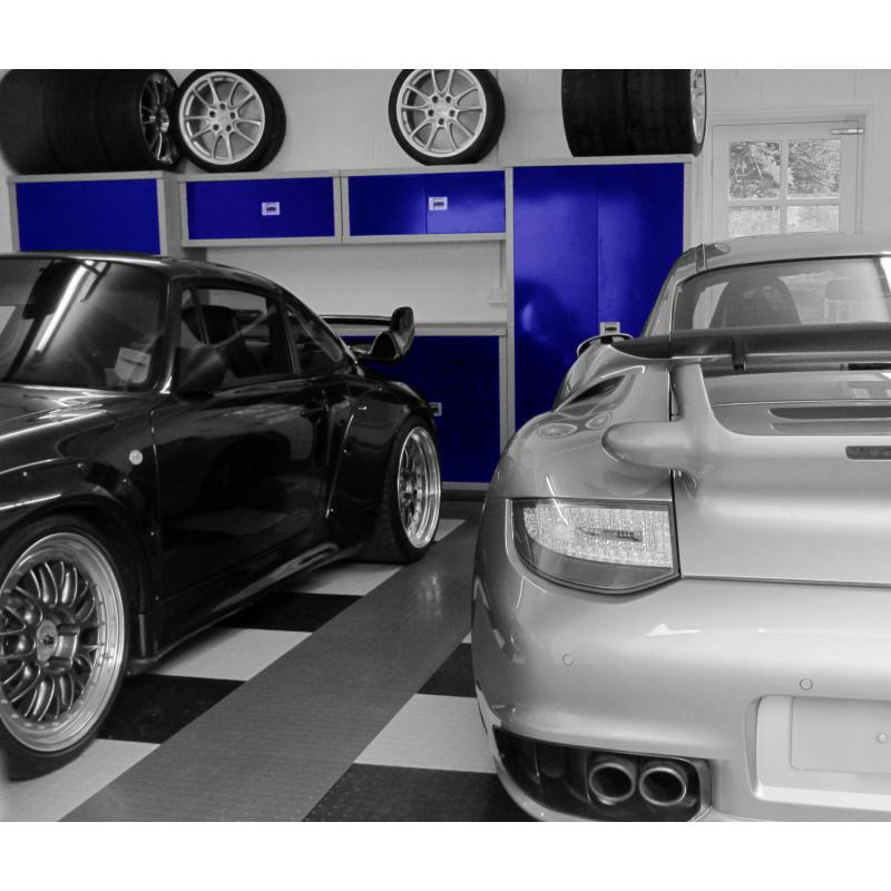 Two fine Porsches with GaragePride cabinets in the background.  The colour was desaturated for effect!