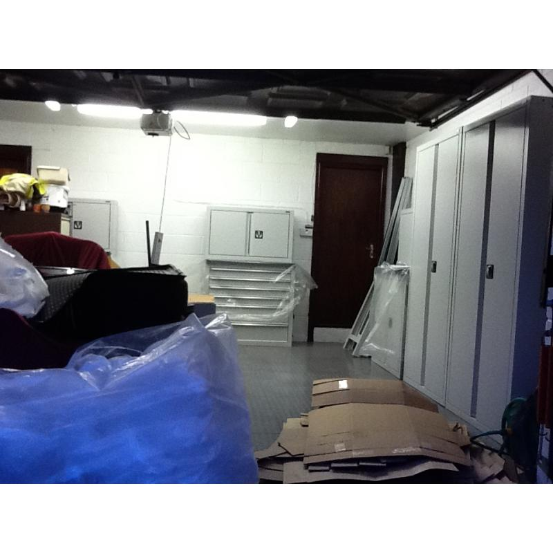 A customer in the process of unpacking and installing his cabinets