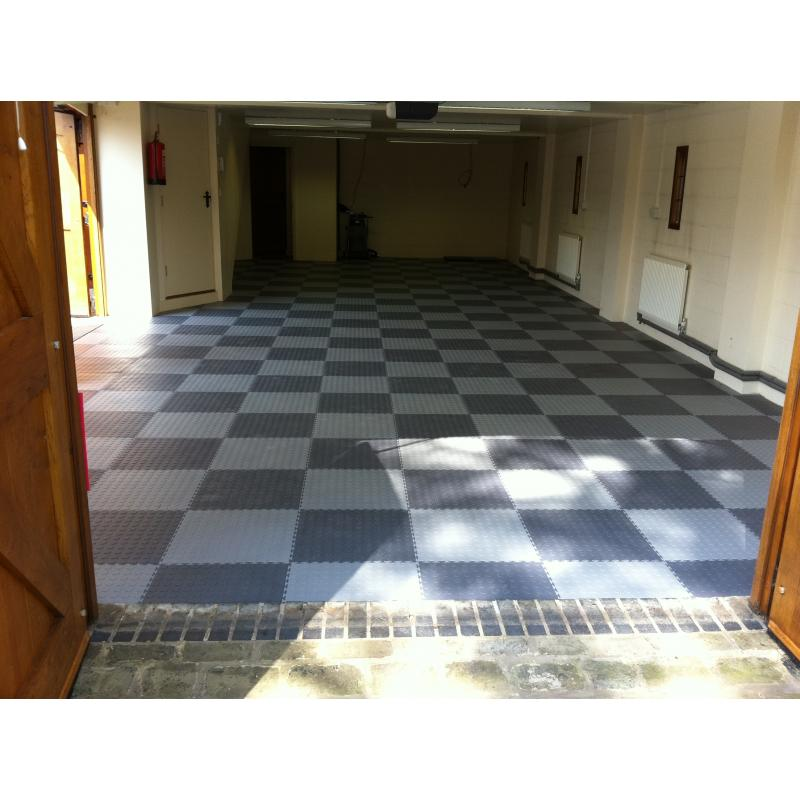 A large garage fitted with 7mm garage floor tiles in a pronounced cheque pattern.