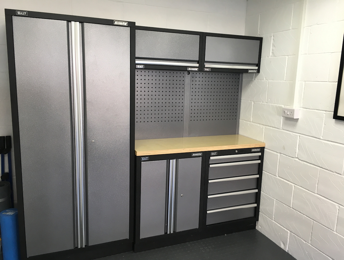A customer's self-fitted corner installation of Sealey Superline Pro cabinets and interlocking floor tiles.