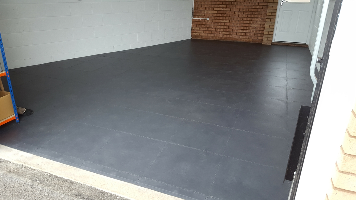 A customer's DIY floor tiles installation completed in a few hours. A garage floor transformed.