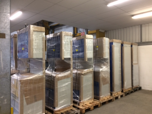 A residential customer's delivery of Bott Cubio cabinets ready for collection by the carrier. Note the base units, back panels and overhead cabinets pre-assembled at the factory for customers' convenience.
