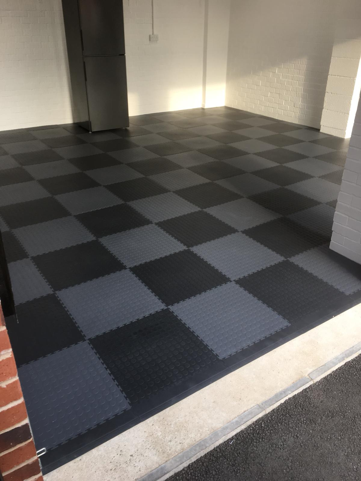 Another garage floor transformed DIY by a customer in a short day. Graphite and dark grey tiles providing a tasteful chequer pattern  Note the front ramps nicely positioned just inside the garage door. All loose laid, not bonded. Dust eliminated and garage floor insulated.