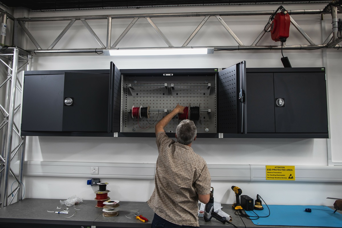 Customer Oxbotica setting up their cable reel storage using our Bott Cubio wall cabinets.