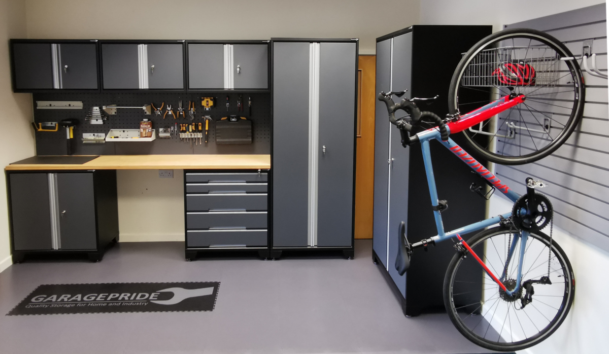 Your garage could look like this! Plenty of storage and room for the car. EvoLine cabinets, Storepanel and EvoTile Professional.