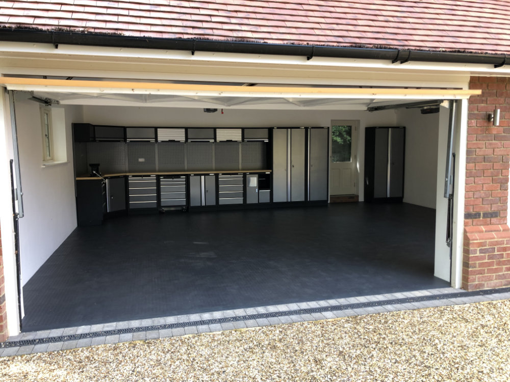 Cabinets and floor tiles supplied and fitted by GaragePride. Plenty of storage and worktop space with the floor transformed with EVOtile Professional PVC tiles.