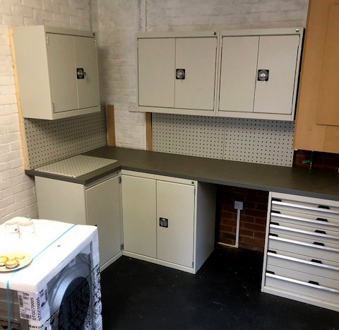 This single garage was recently fitted with interlocking tiles and Cubio cabinets on the back wall leaving space for a washing machine. The boiler was boxed in top right.