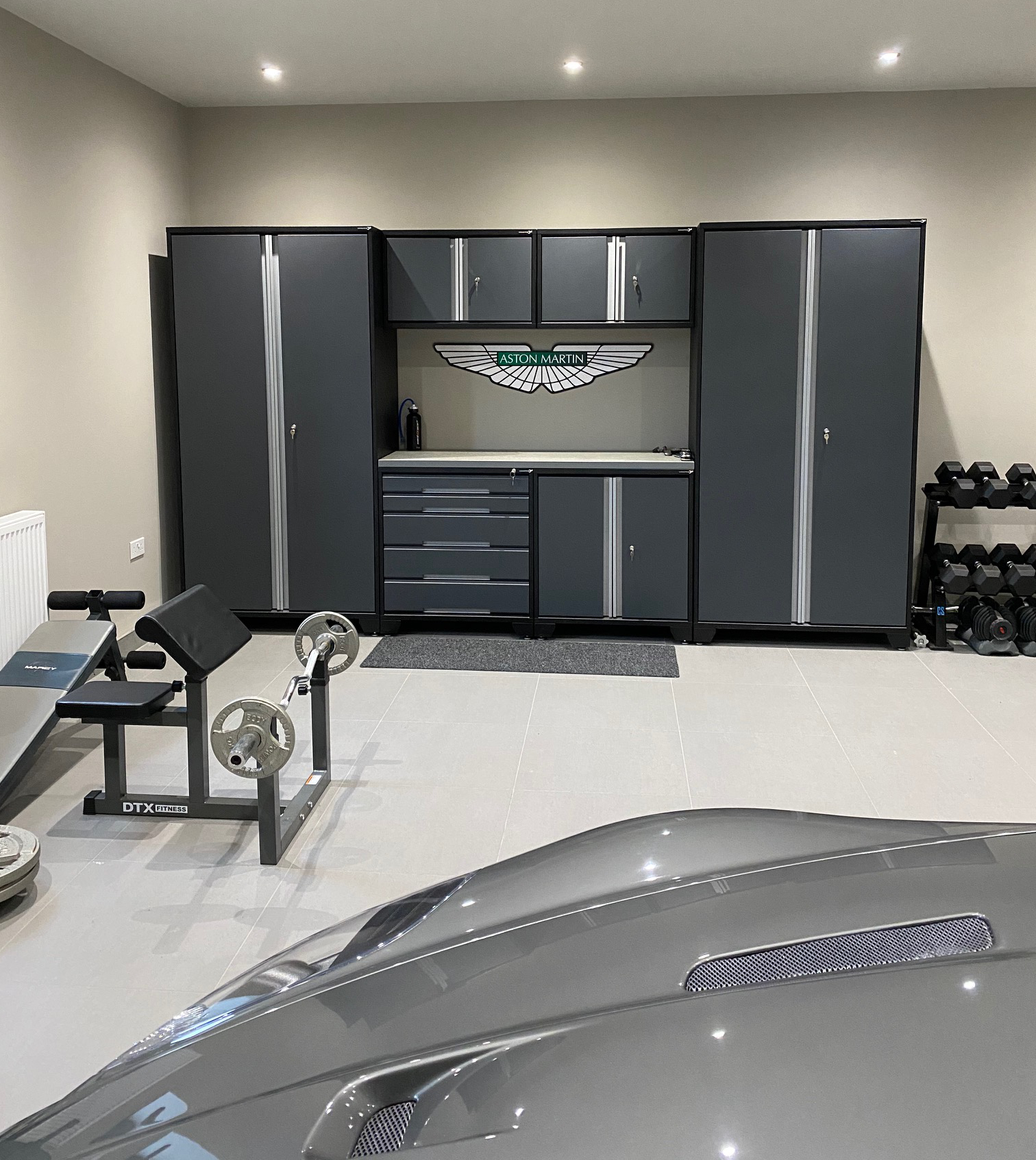 GaragePride Evoline cabinets in a customer's newly built garage housing his Aston Martin.