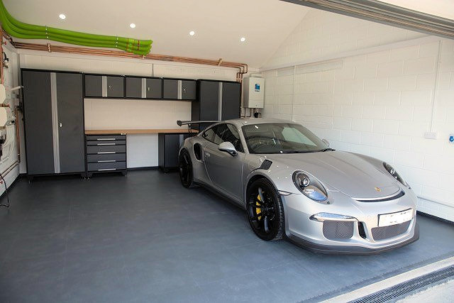 Thank you to our customer for sending us this picture of his beautiful Porsche. GaragePride cabinets, EvoTile and simply white painted walls provide a nice clean appearance.
