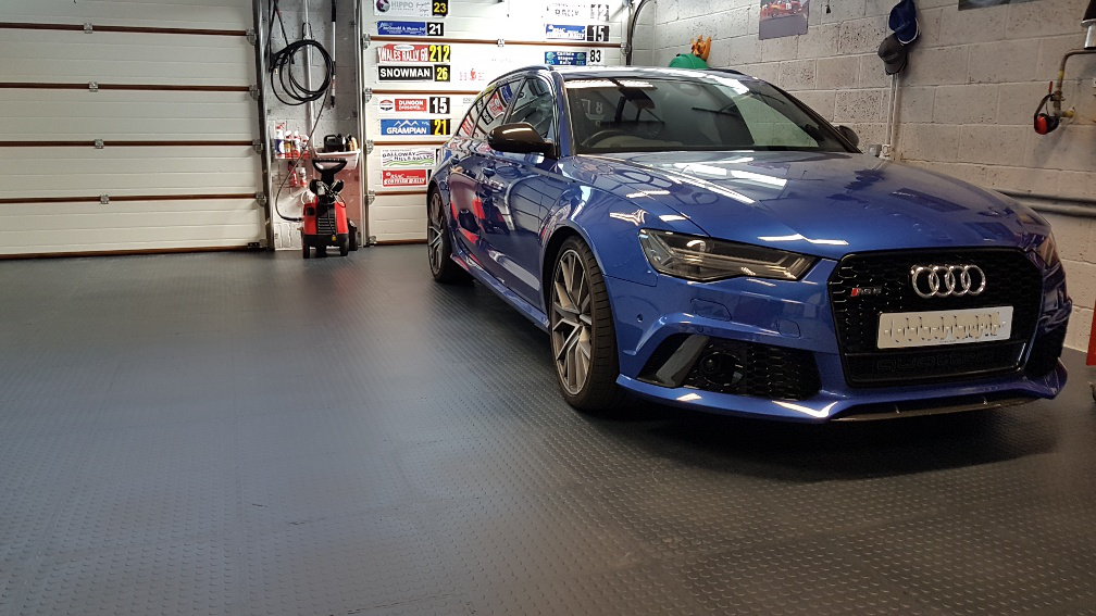 This happy customer sent us photos of his EvoTile floor fitted last weekend. They really do transform a garage floor and somehow make a good looking car look even better.