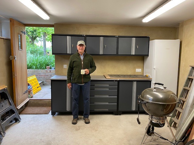 Customer Ray enjoying a tea break having fitted his GaragePride EvoLine cabinets on the back wall. They're a perfect fit between door and freezer.