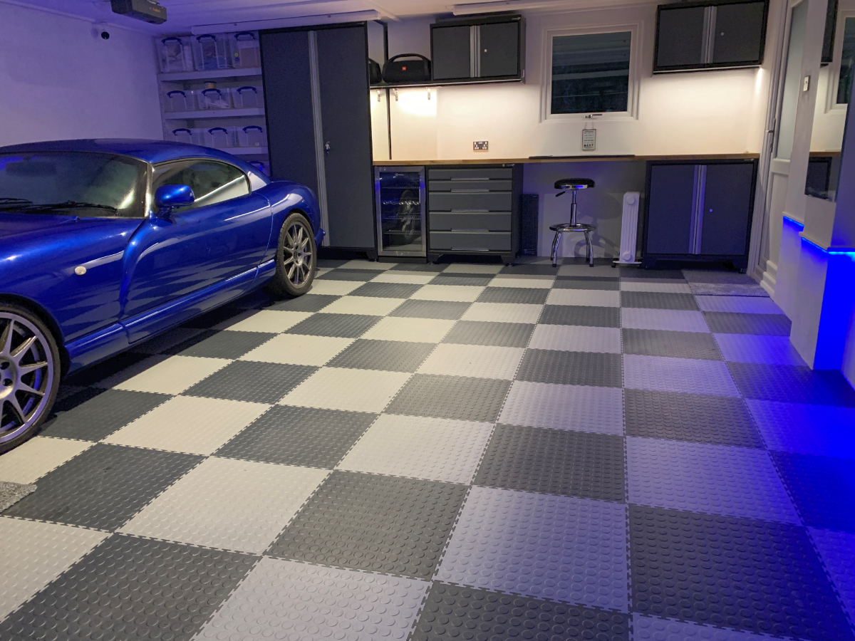 Our customer's TVR given a home in a dust free garage with insulated floor. The cabinets are GaragePride EvoLine with plenty of storage and worktop space. A great job finished off with coloured accent lighting.