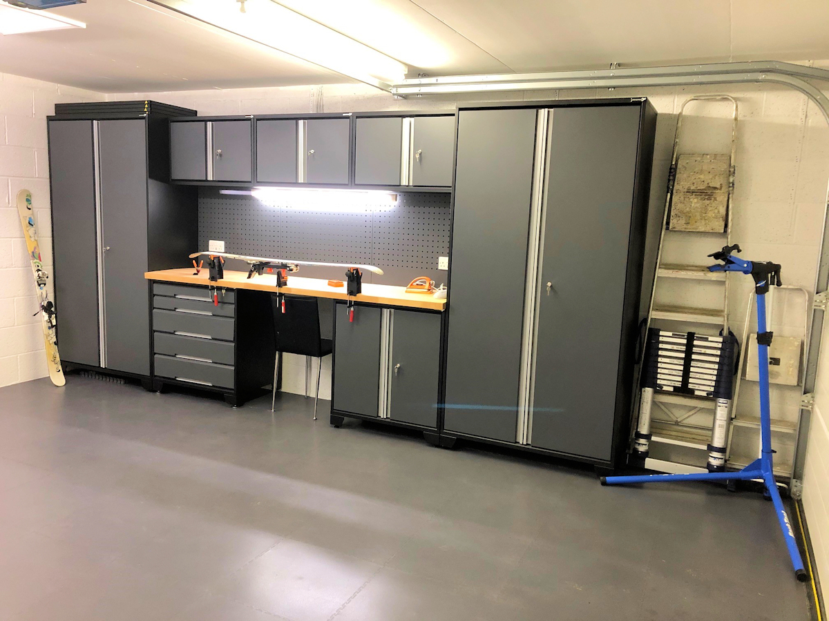Our customer has added power sockets and under cabinet lighting to his EvoLine cabinet layout. The 2.1 metres high cabinets fit snugly beneath the garage door rail. Dark grey, smooth texture EvoTile covers the concrete floor. Could your sport or hobby be enhanced with good quality cabinets and worktop?