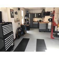 Customer Andy Watson, Colchester. Highly functional home garage. Light grey tiles for lightness with black stripes to hide tyres marks.