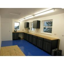 A customer's workshop using NewAge Pro Series cabinets. Note the bench drill and grinder mounted on the worktop.