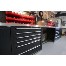 Drawer storage and small parts.  The customer supplied the stainless steel worktops.