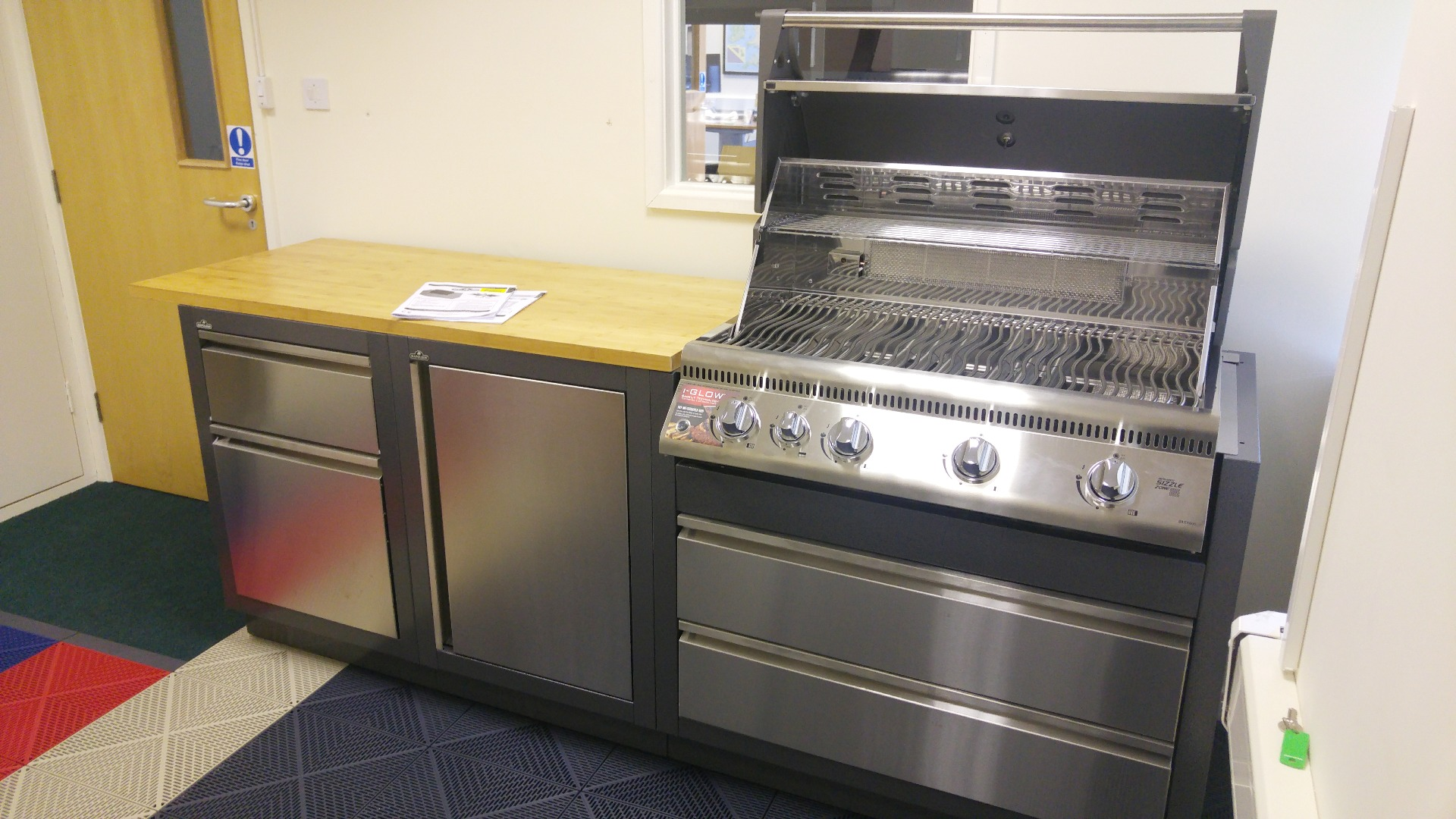 Napoleon cabinets and grill in showroom